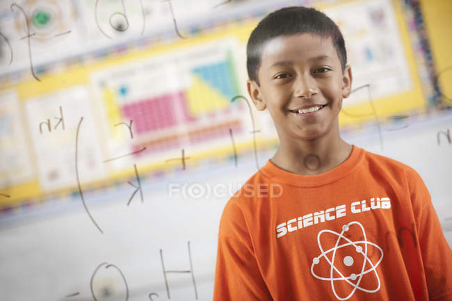 Boy looking at a board — Stock Photo