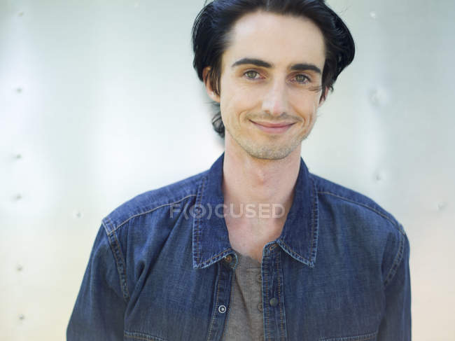 Young man wearing a denim shirt — Stock Photo