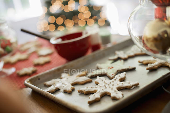 Baking tray of homemade Christmas cookies — Stock Photo