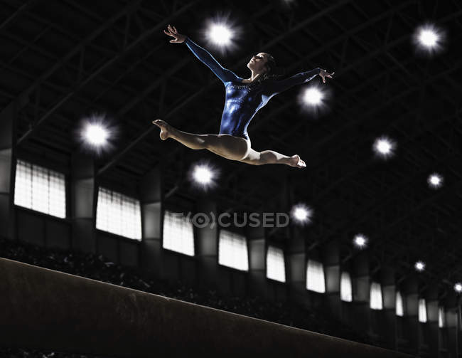 Young woman performing a floor routine — Stock Photo