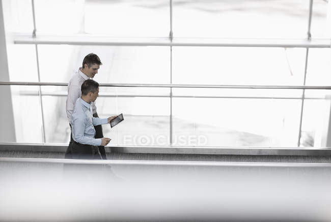 Businessmen by the large windows of a building — Stock Photo