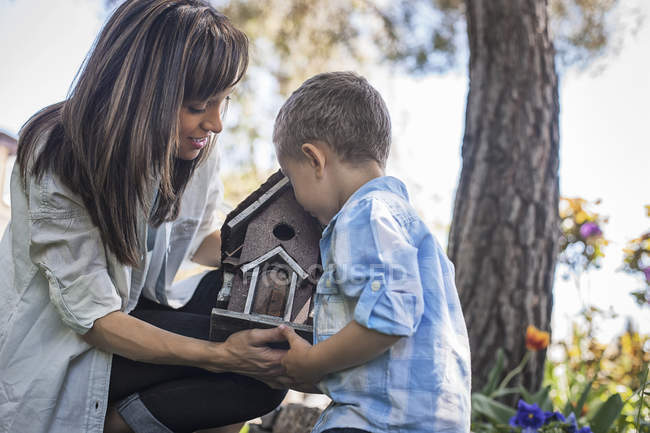 Child and adult looking at a bug box — Stock Photo
