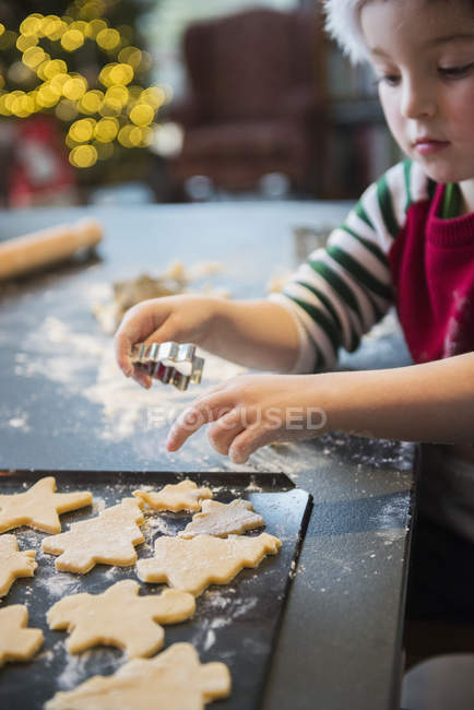Boy making Christmas biscuits — Stock Photo