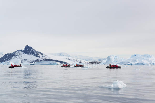 Group of people in a rubber boats in the Antarctic. — Stock Photo