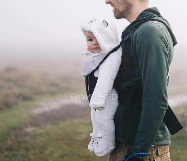Man carrying a baby — Stock Photo