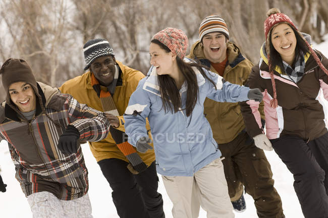 People running across the snow. — Stock Photo