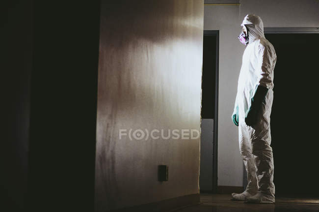 Man wearing protective clean suit — Stock Photo