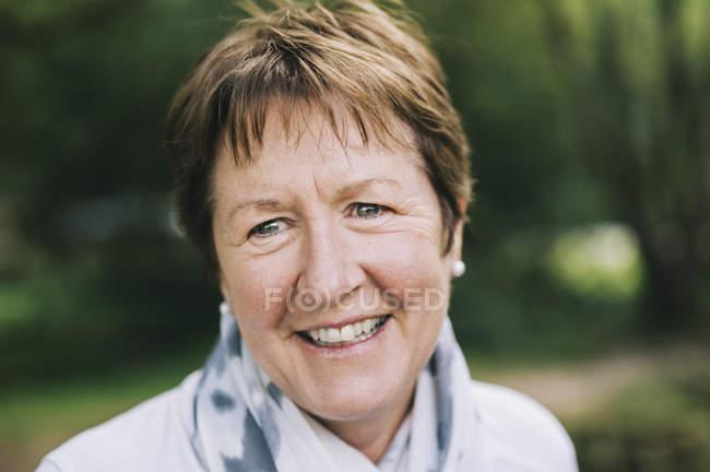 Mature woman smiling — Stock Photo