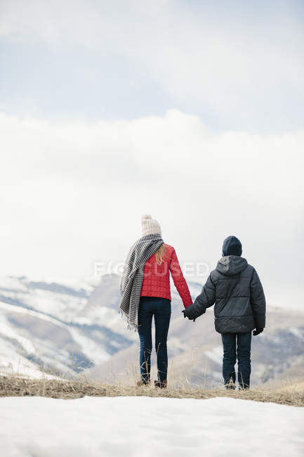 Brother and sister standing side by side — Stock Photo