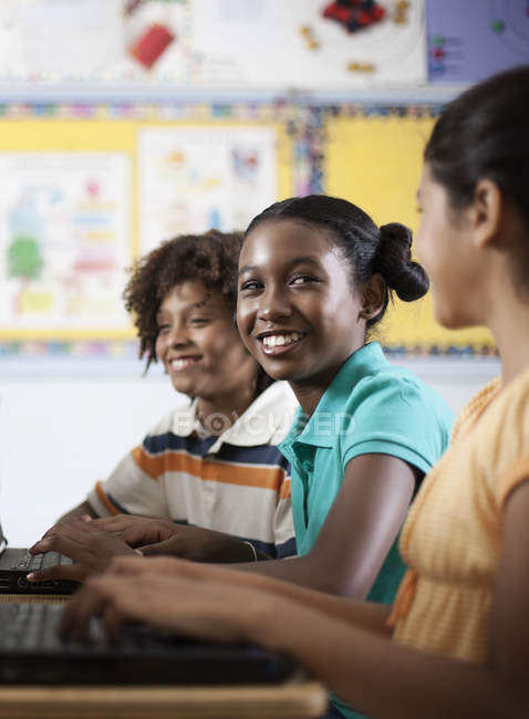 Three students sitting in class — Stock Photo