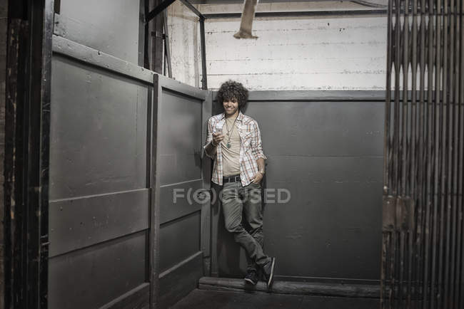 Man in a loft elevator — Stock Photo