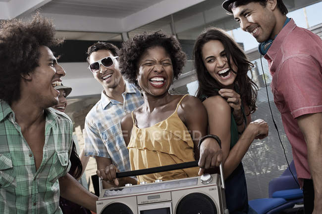 People with a large portable music player — Stock Photo