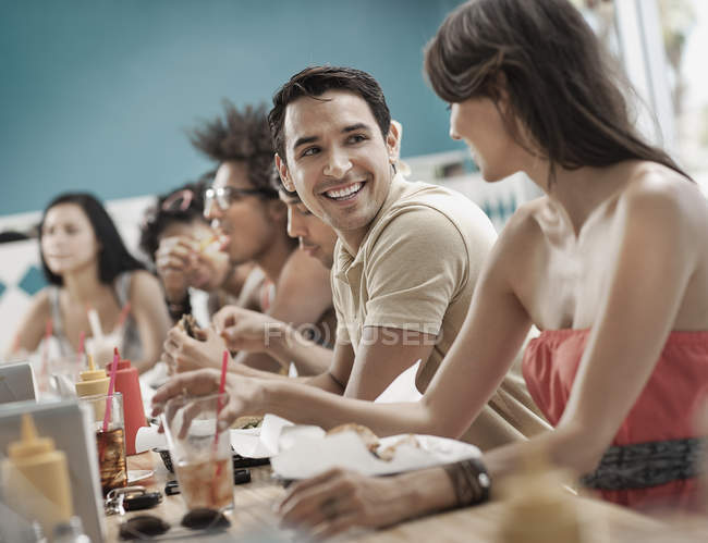 Men and women at a diner. — Stock Photo