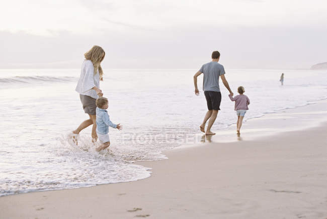 Couple playing with their son and daughter — Stock Photo