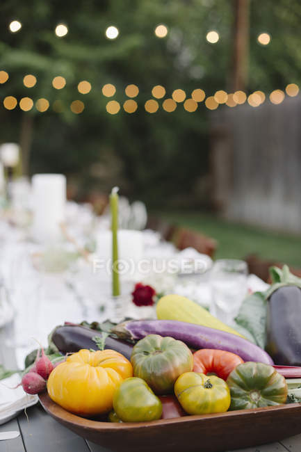 Bowl of vegetables in the foreground. — Stock Photo