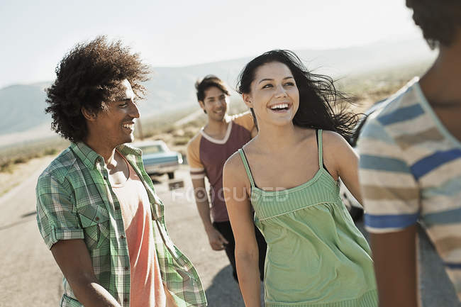 Men and woman on the open road — Stock Photo