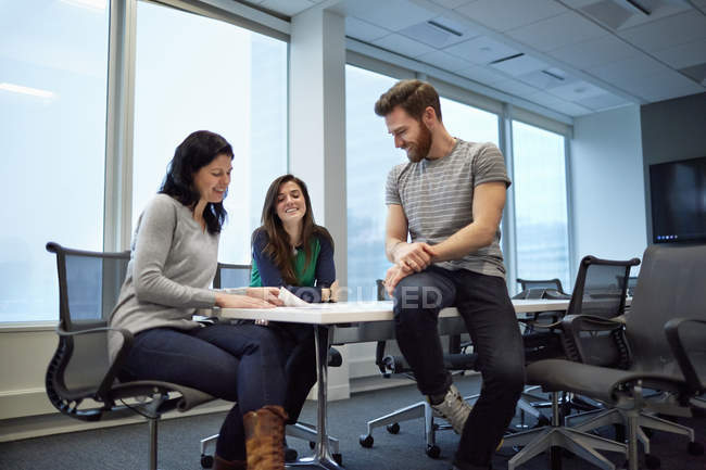 Three colleagues at a meeting — Stock Photo