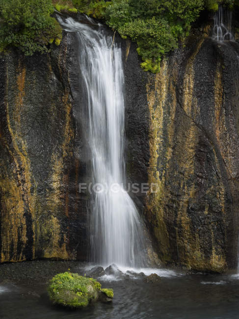 Cascade of water into a pool. — Stock Photo