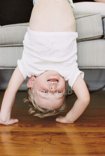 Little boy doing a handstand — Stock Photo