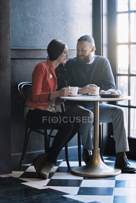 Couple seated side by side — Stock Photo