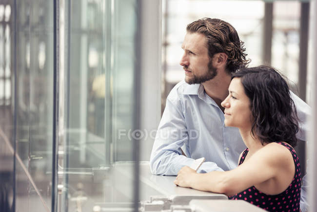 Man and woman side by side outside — Stock Photo