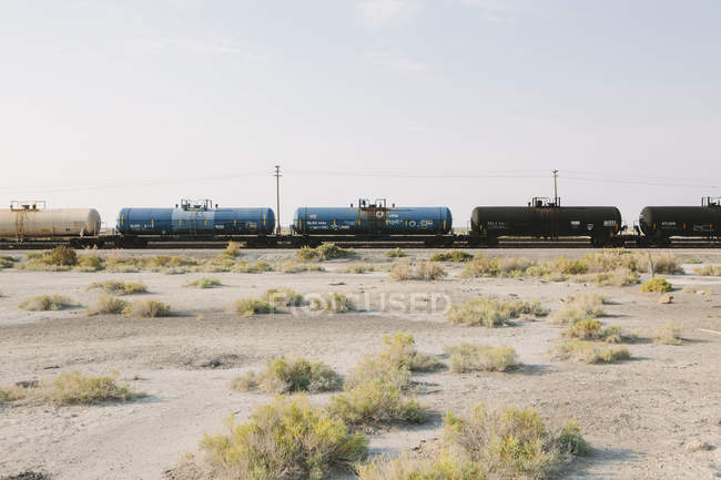 Train track running through the desert — Stock Photo