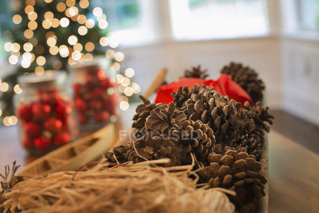 Red glass balls and pine cones — Stock Photo