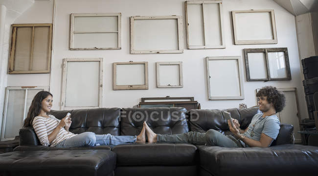 Couple sitting on the sofa — Stock Photo