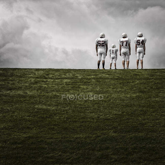 Joueurs de football en uniforme de sport — Photo de stock