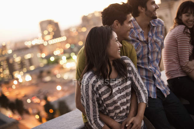 Friends gathered on a rooftop terrace — Stock Photo