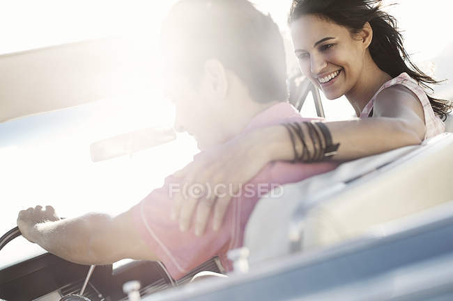 Couple in a pale blue convertible — Stock Photo