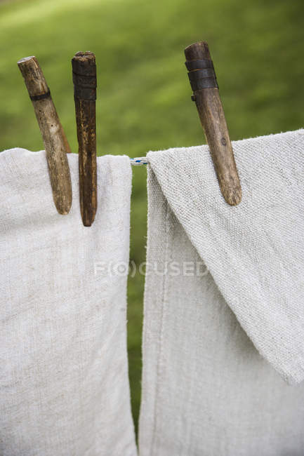 Washing line with household linens — Stock Photo