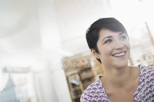 Woman at home laughing — Stock Photo