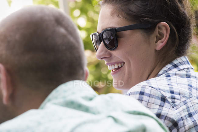 Young man and woman sitting side by side — Stock Photo