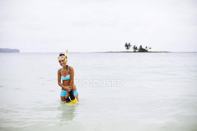 Woman wades in shallow water — Stock Photo