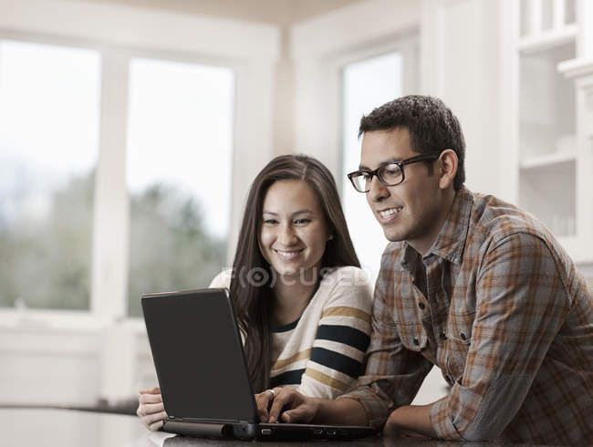 Couple using a laptop computer. — Stock Photo