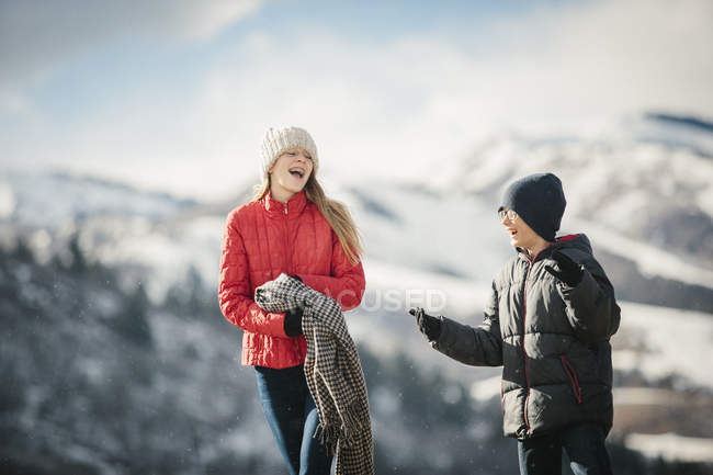 Brother and sister together outdoors in winter — Stock Photo