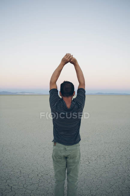 Man stretching with arms above head — Stock Photo