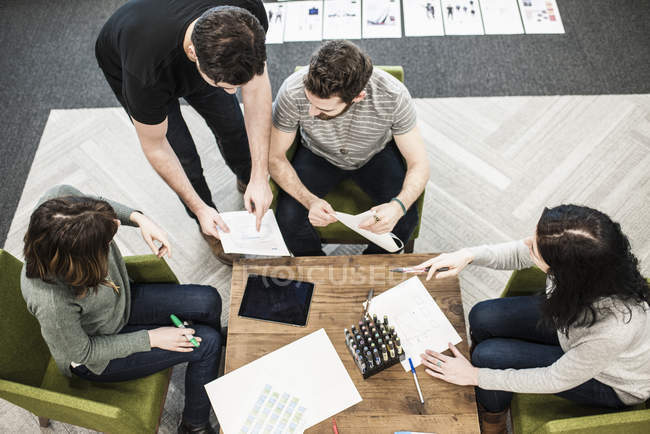 Four people seated at a table — Stock Photo