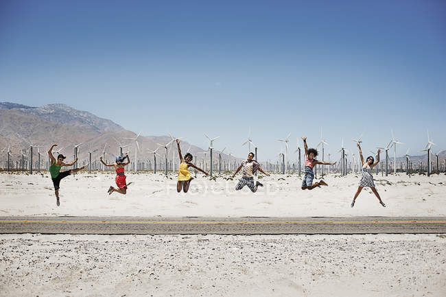Six young people leaping in the air — Stock Photo