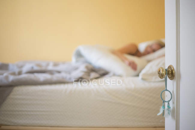 Woman sleeping in a bed. — Stock Photo