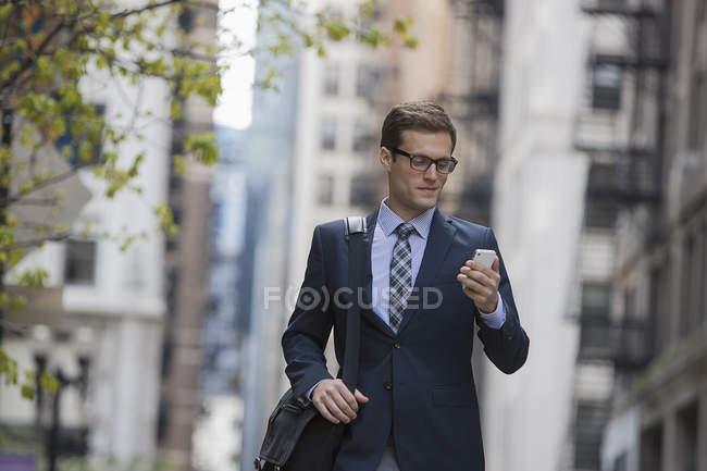 Businessman checking his phone. — Stock Photo