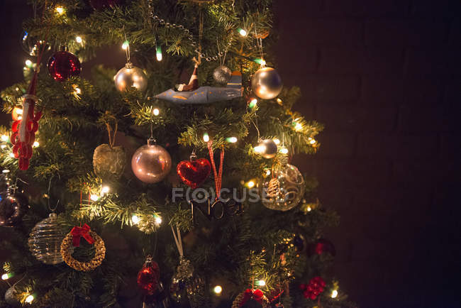 Christmas tree decorated with lights. — Stock Photo
