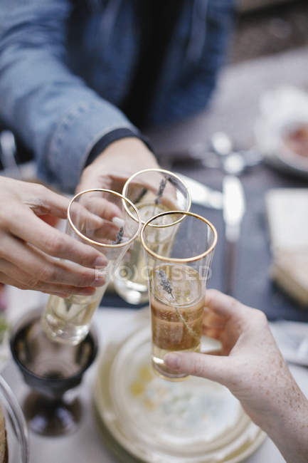 Three people making a toast — Stock Photo