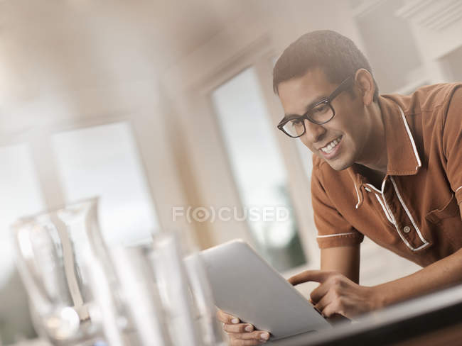 Hispanic man using a digital tablet. — Stock Photo