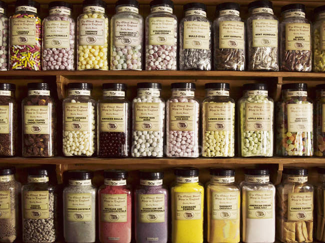 Sweets displayed in tall glass jars — Stock Photo