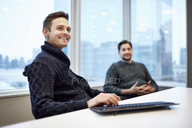 Two men in a office — Stock Photo