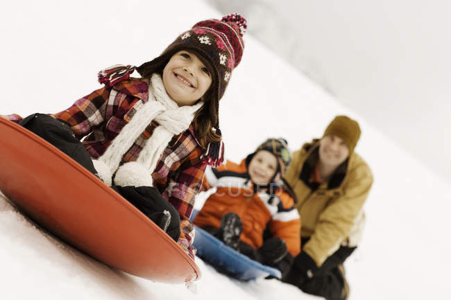 Two children riding on sledges — Stock Photo
