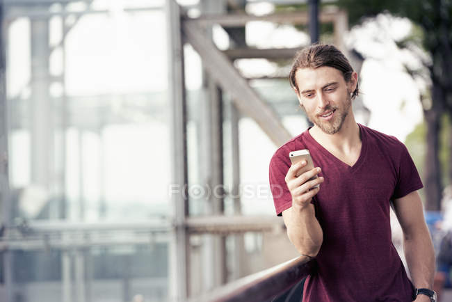 Young man checking his cell phone — Stock Photo