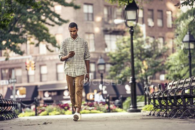 Man walking through a town square — Stock Photo